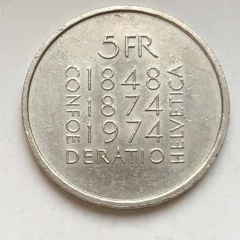Интересная швейцарская монета