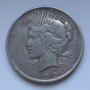 Монета доллар серебро